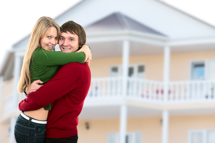 happy young couple and home